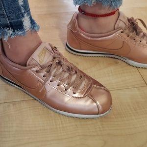 Rose gold Nike Cortez
